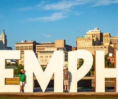 two person standing on memphis wall